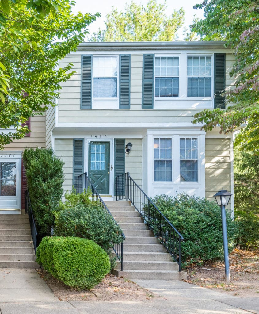 A townhome in North Reston, vinyl siding with concrete stairs walking up