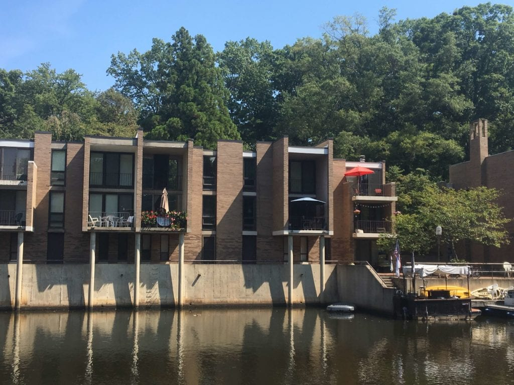 Waterfront townhomes on Lake Anne in Reston, make of brick and concrete.