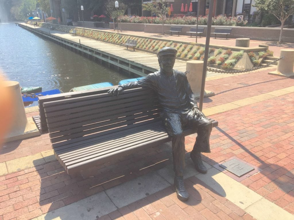 A bronze statue of Robert E Simon, founder of Reston VA and developer of the original townhome clusters.