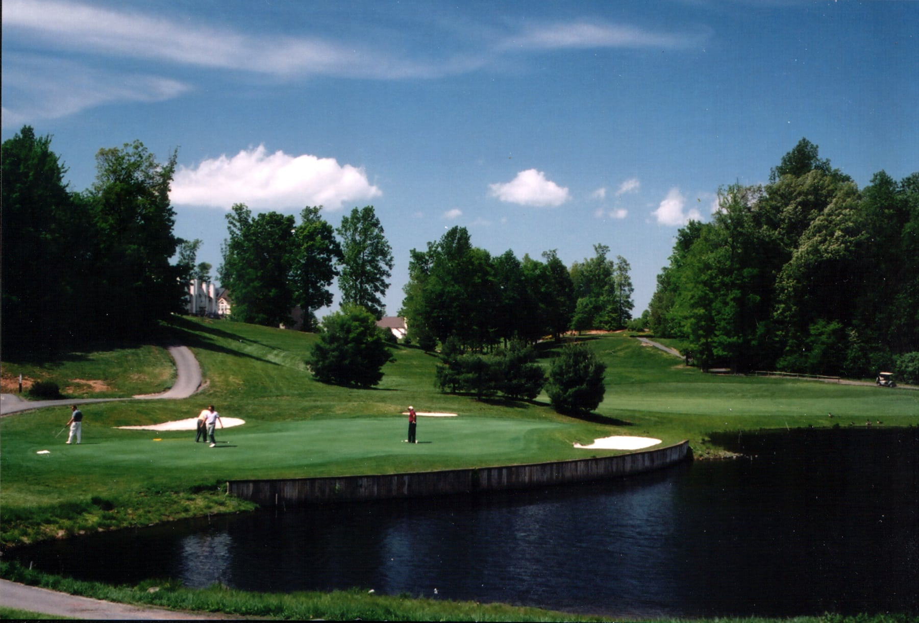 Penderbrook's golf course with water hazard and green in background