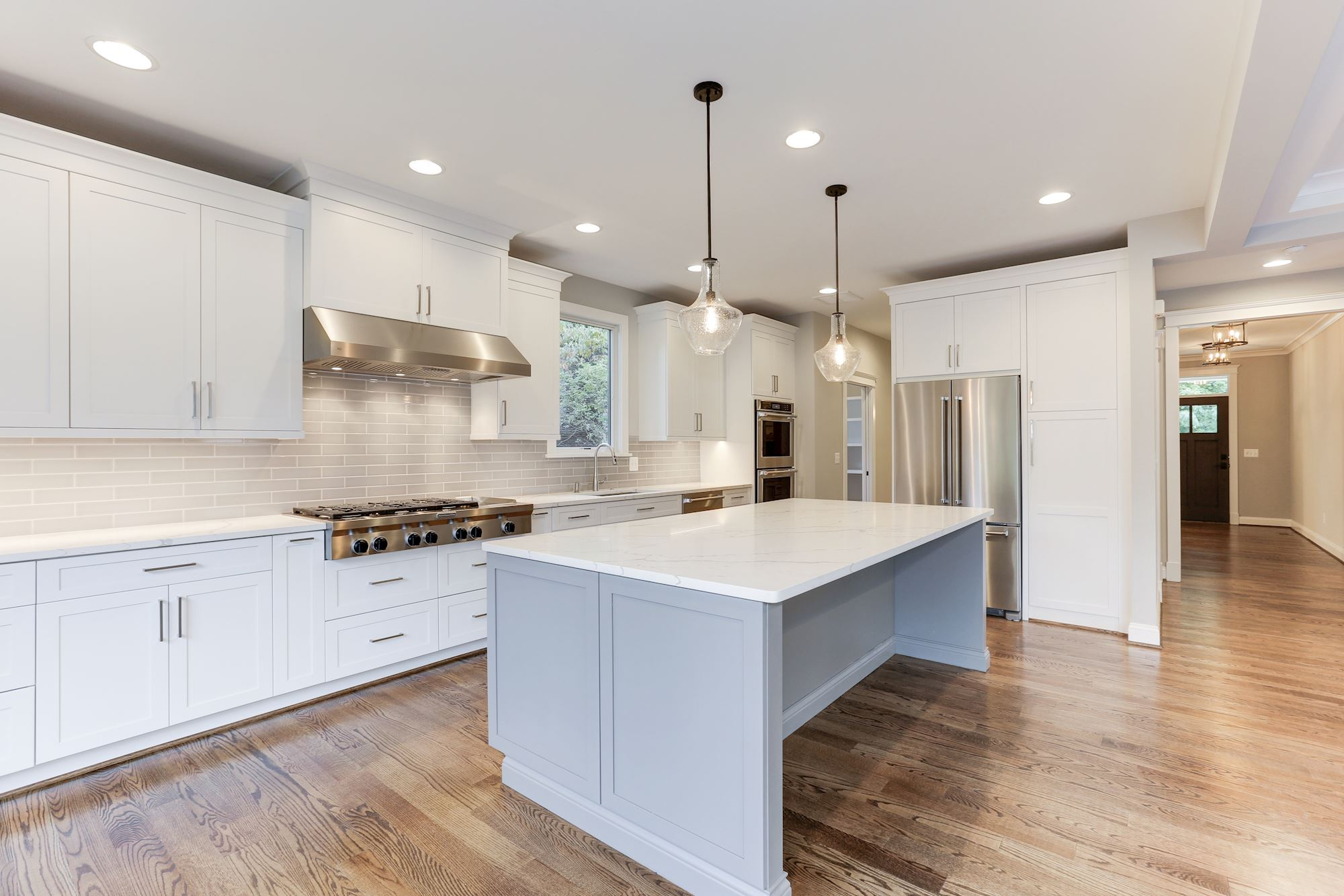 Modern kitchen with white counters and cabinets