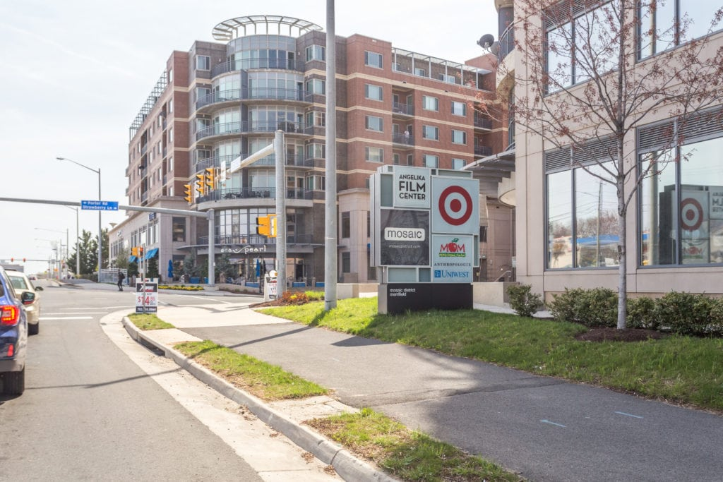 Mosaic district in Fairfax VA. The sign with the stores is shown. Closeby to Covington townhomes.