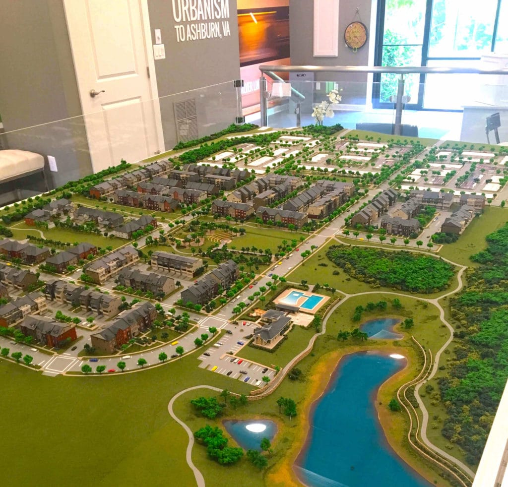 A model of a new luxury townhome community in Northern VA. Shows the layout of the neighborhood and also the nearby amenities.