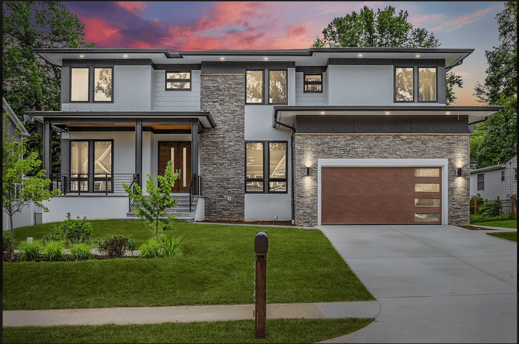 New modern luxury home in Falls Church. Rectangular home gives a modern feel and lights are on throughout the house.