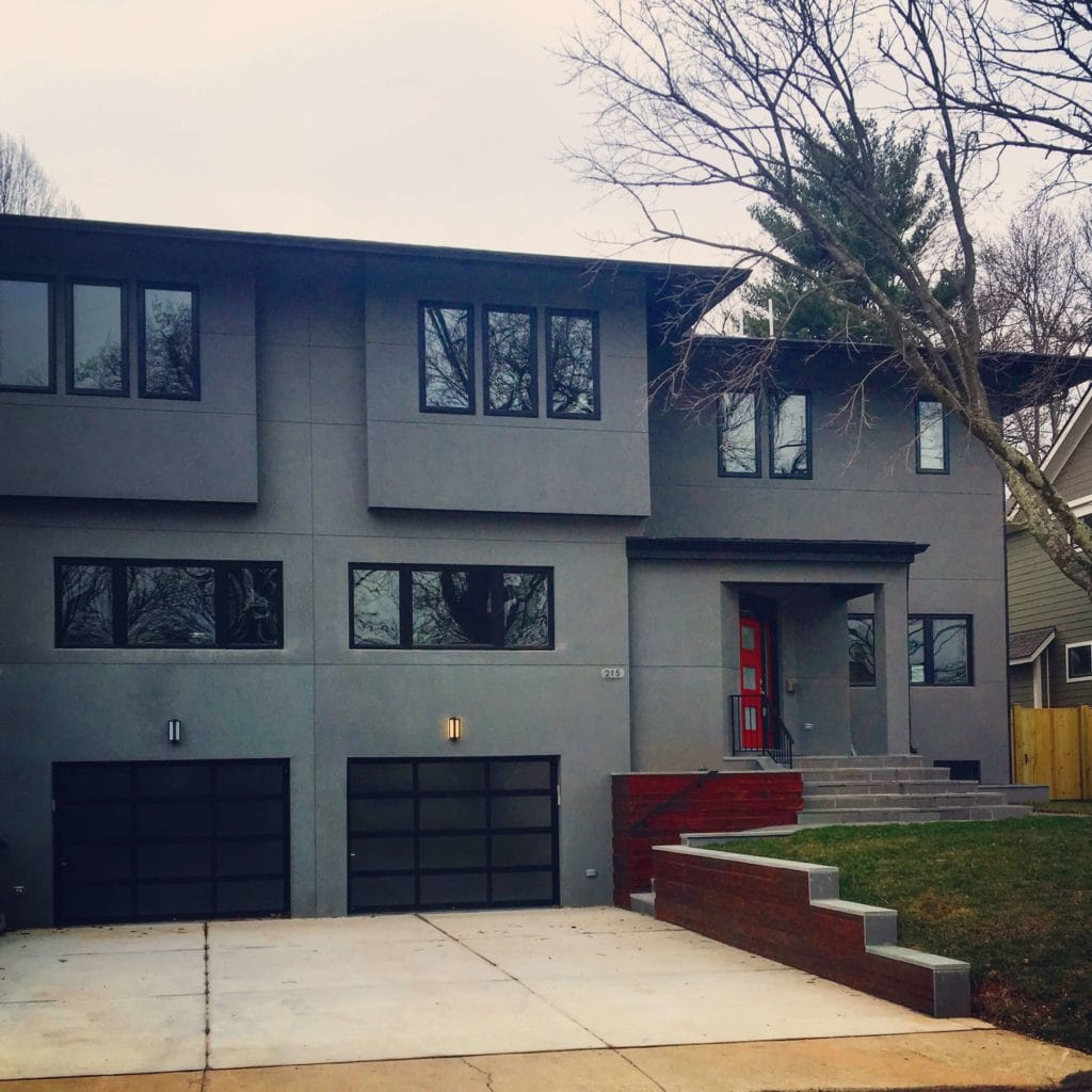 A new construction home made of concrete in Falls Church VA. Dark grey and red door