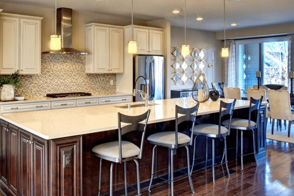 The interior (kitchen) is shown of a model home in Fairfax County.