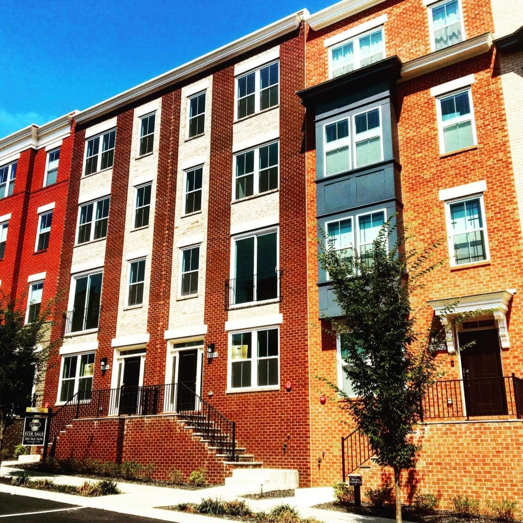 New townhome community in Reston. Colorful brick and siding.