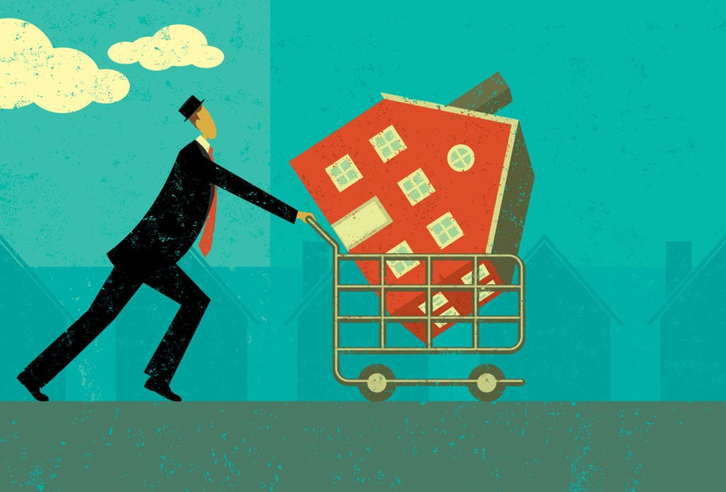 Man in black suit takes a home away in a shopping cart. Meant to symbolize foreclosure. This is a vector image.