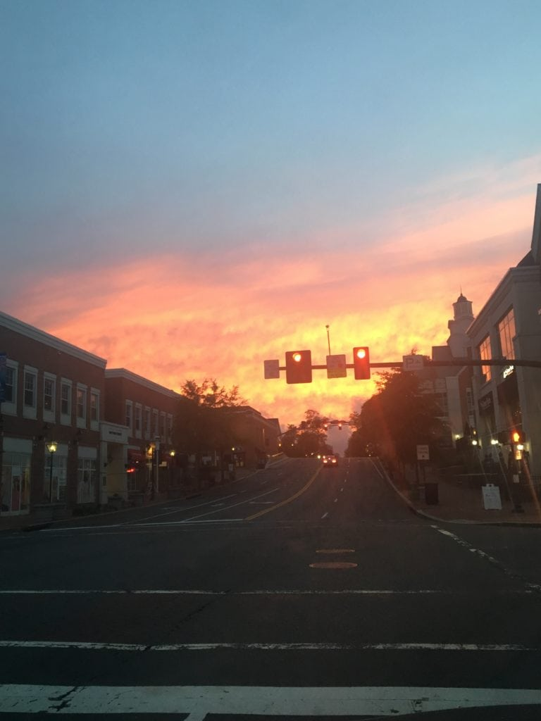 Sunset shown on the backdrop of a small town street.