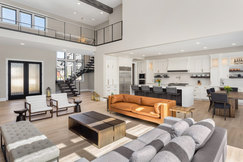 A completed new construction modern home with tasteful furniture and light and bright open concept.