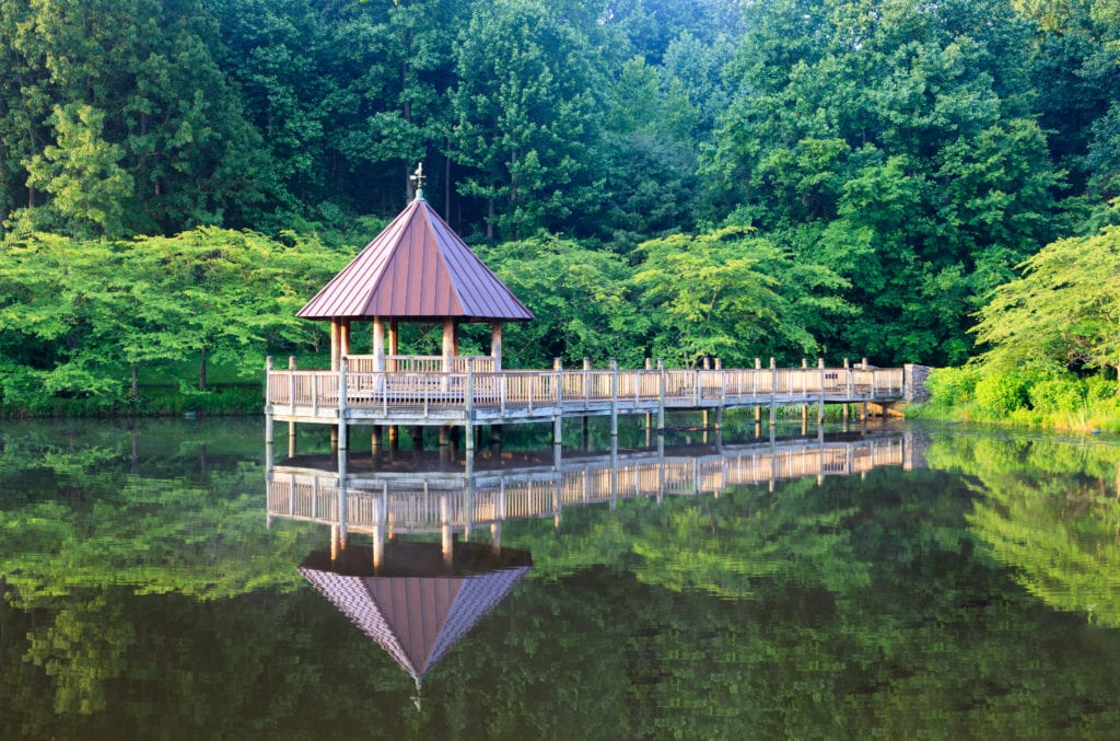 A gazebo with a dock set over a small man made lake in Vienna VA.