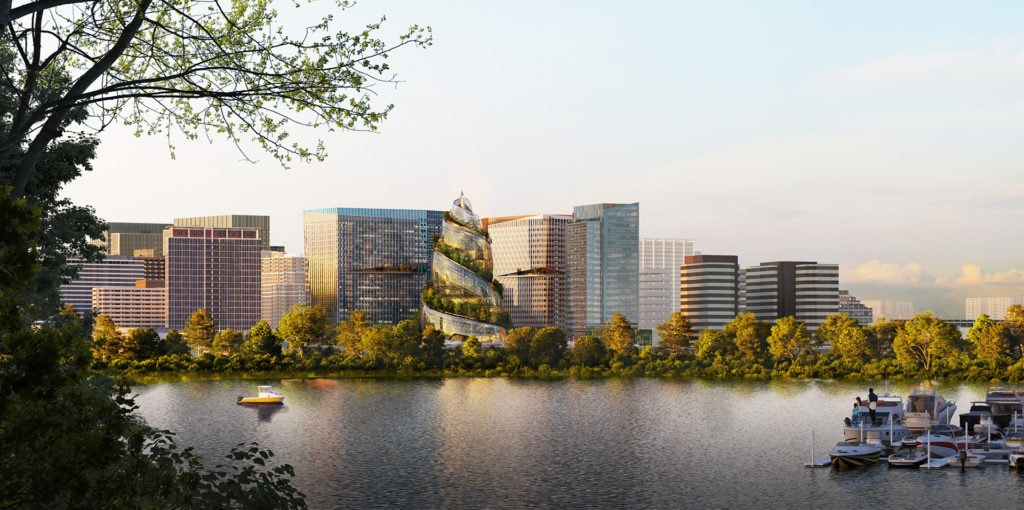 A rendering shows a futuristic building that resembles a helix, with trees growing throughout. Skyline of National Landing in the background.