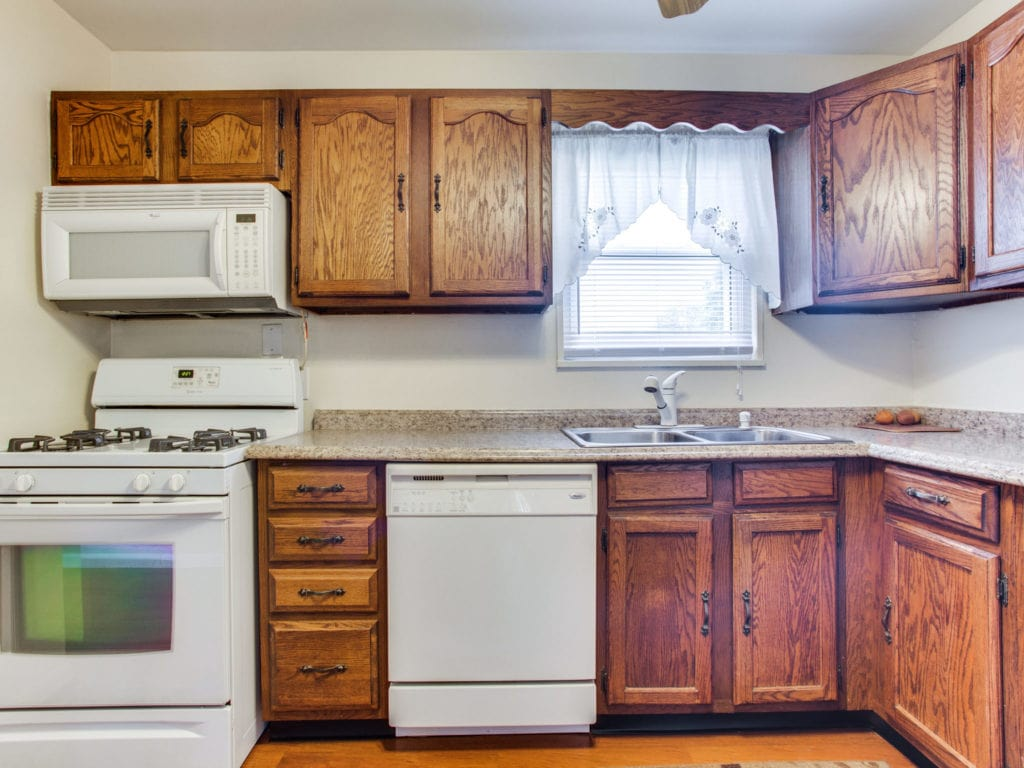 A clean, but dated kitchen.