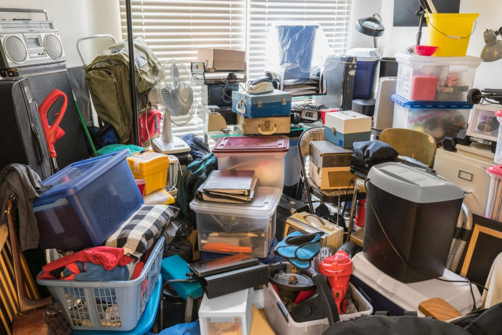 A cluttered room so full of things you cannot see the floor.