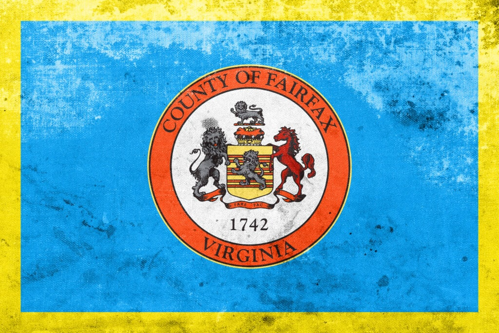 The Fairfax County flag with lions and a crest and established date of 1742.