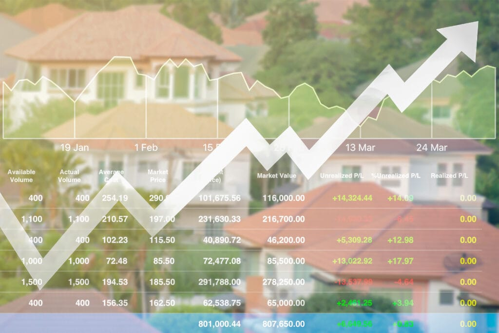 A stock image of a chart trending upward, and a residential neighborhood in the background.