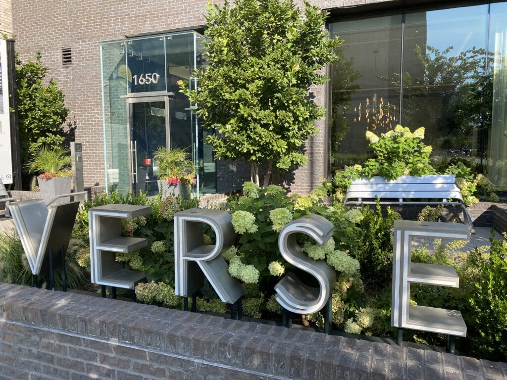 A sign at the front of a condo community in Tysons Corner, McLean VA. The Sign says 'Verse', with some landscaping in the background.