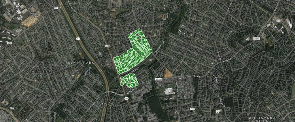 A satellite image with the homes in the residential neighborhood of Devon Park marked green. Various roads are also marked by name.