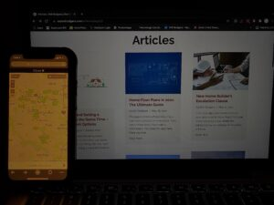 Photo of a real estate website being displayed on both a laptop and a smartphone.